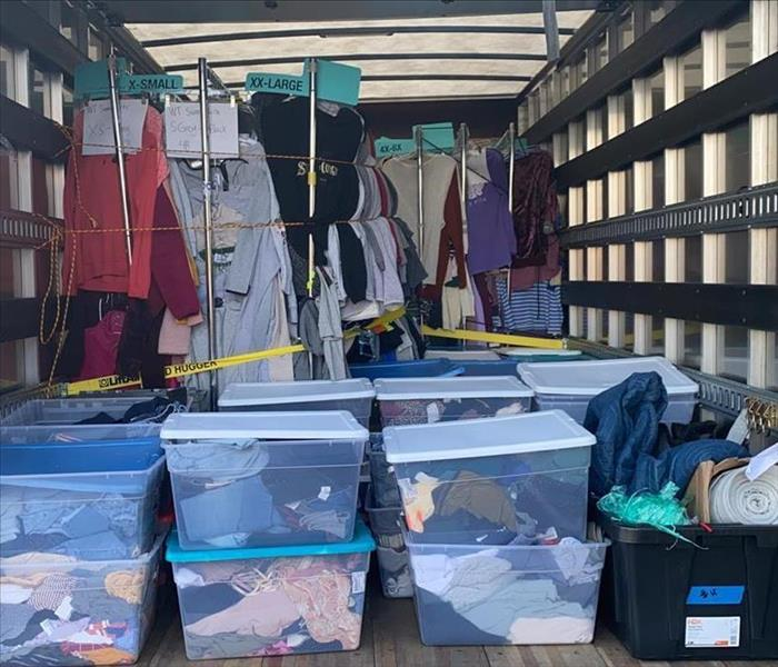 box truck full of bins and clothing