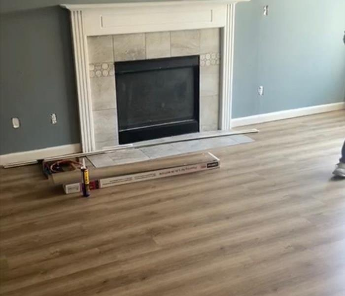 Refinished fireplace and flooring