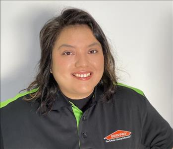 woman in servpro polo smiling at camera